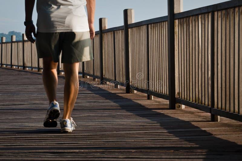 Man walking on boardwalk
