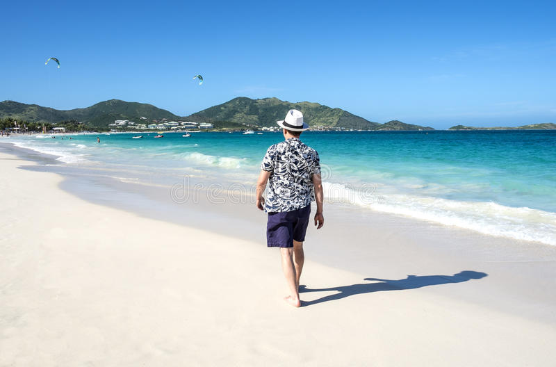 Man Walking on a Caribbean Beach 1 royalty free stock photography
