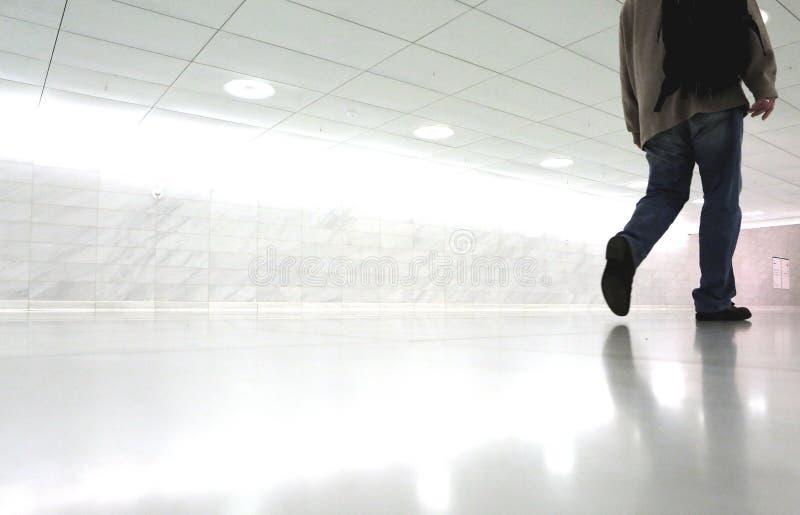Man walking in corridor stock image