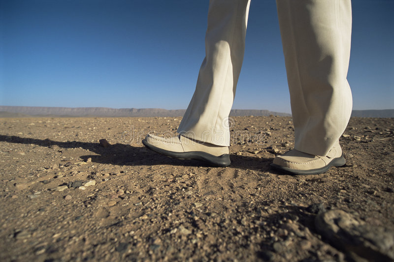 Download Man Walking In Desert, Low Section Stock Image - Image: 6078539