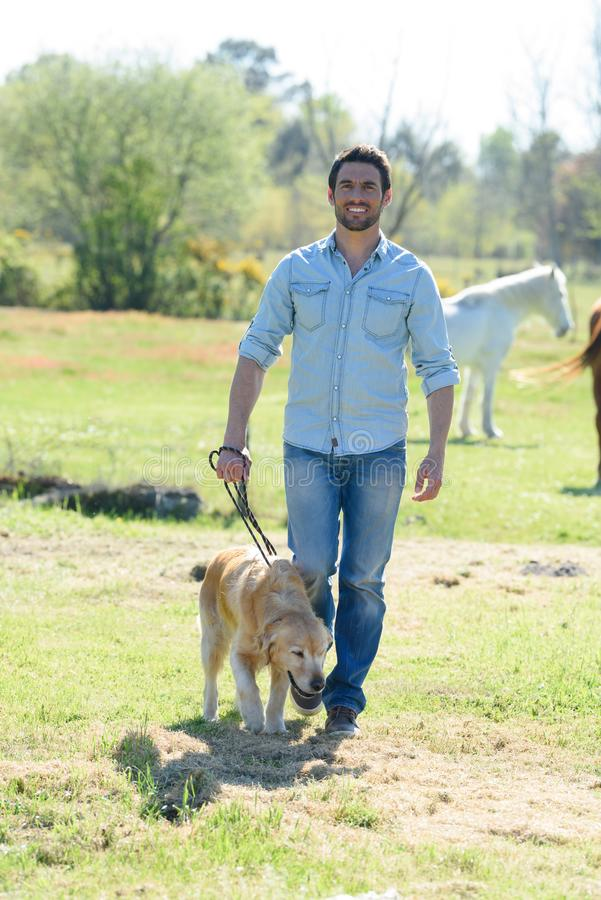 Man walking with dog. Man walking with a dog stock photo