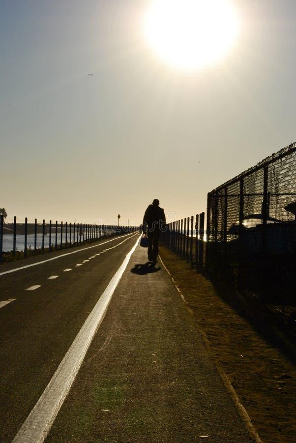 Man Walking Down The Boardwalk Stock Images