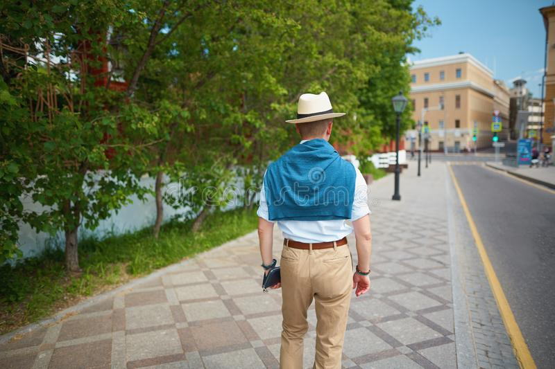 elegant man walking on a city street royalty free stock image