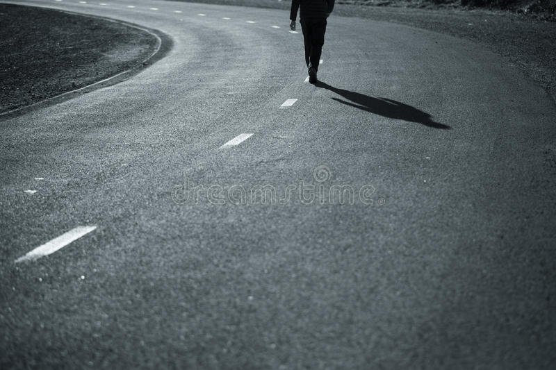 Man walking in the middle of the road royalty free stock images