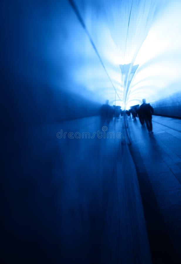 Man walking in Moscow metro blue background. Vertical orientation vivid vibrant color rich composition design concept element object shape backdrop decoration stock photo