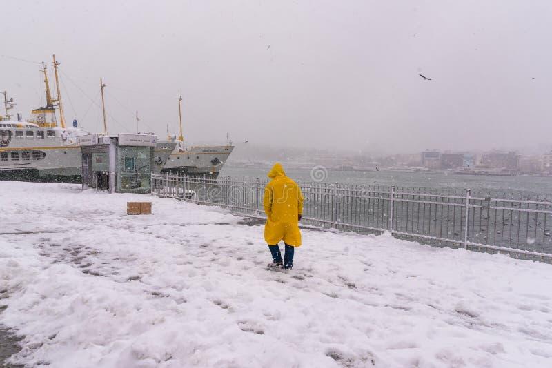 Man walking near bosphorus on the heaviest snowfall. Unidentified man walking near bosphorus on the heaviest snowfall in Istanbul,Turkey stock photography