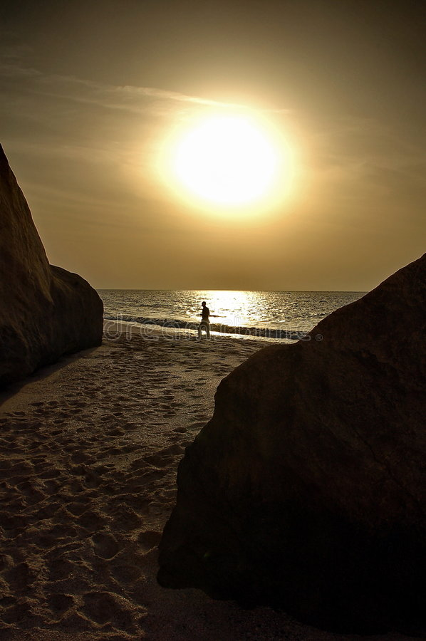 Man walking in a Oman beach stock images