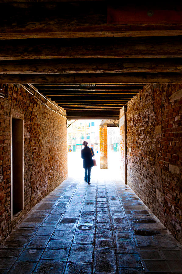 Free Man Walking Out Of Tunnel Royalty Free Stock Photography - 24682217