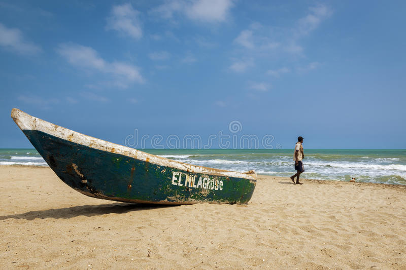 Man walking in the Palomino Beach in the Caribbean Coast of Colombia stock image