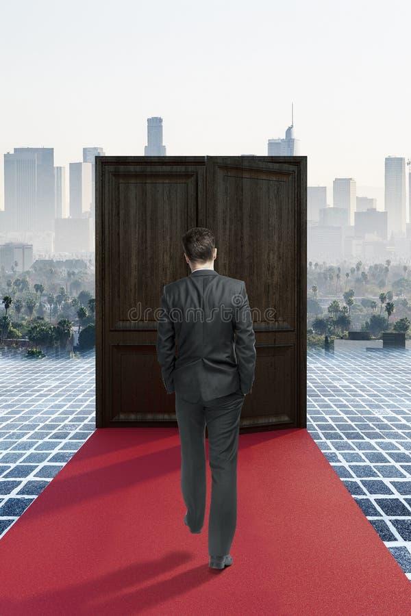 Man walking on red carpet to success royalty free stock images