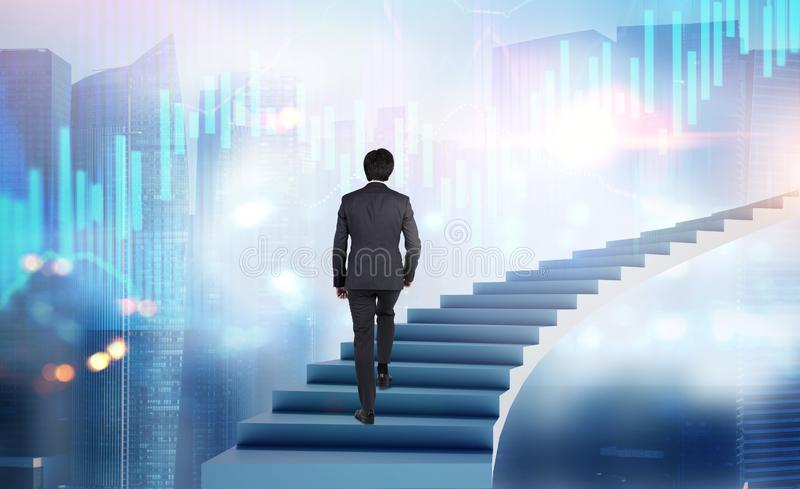 Man walking on stairs in city with graphs stock image