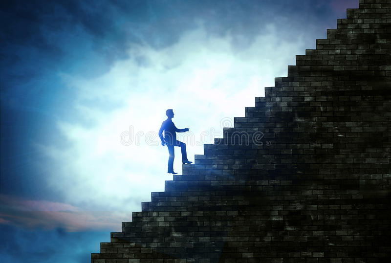 Man walking the stairs to success, steps to success in business. Silhouette of man walking the stairs to success, steps to success in business concept royalty free stock photo