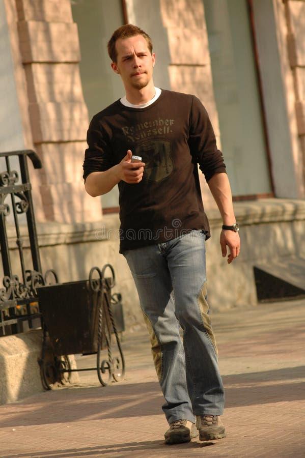 Man walking street stock photo