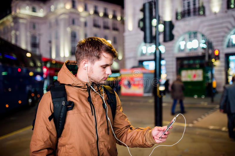 Man walking in the streets of London at night royalty free stock photography