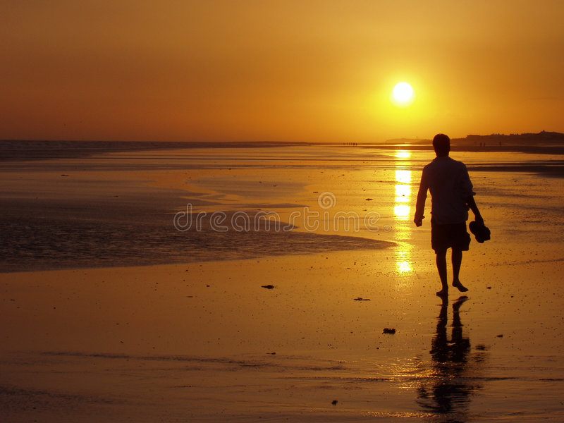 Man Walking At Sunset Stock Image