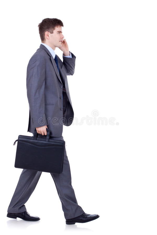 Download Man Walking And Talking On Phone Stock Image - Image: 18593121