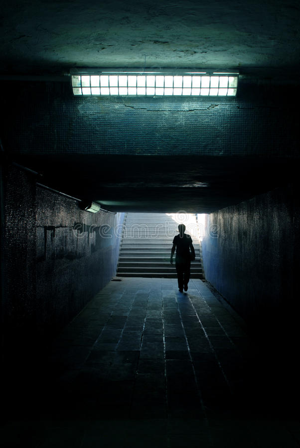 Download A Man Walking In The Tunnel Stock Photo - Image: 10392112