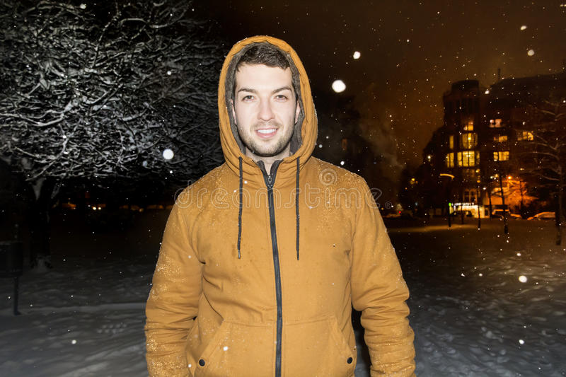 Man walking in the winter park by night. Beautiful Winter night landscape in the South Park in Sofia, Bulgaria.Night scene royalty free stock photography