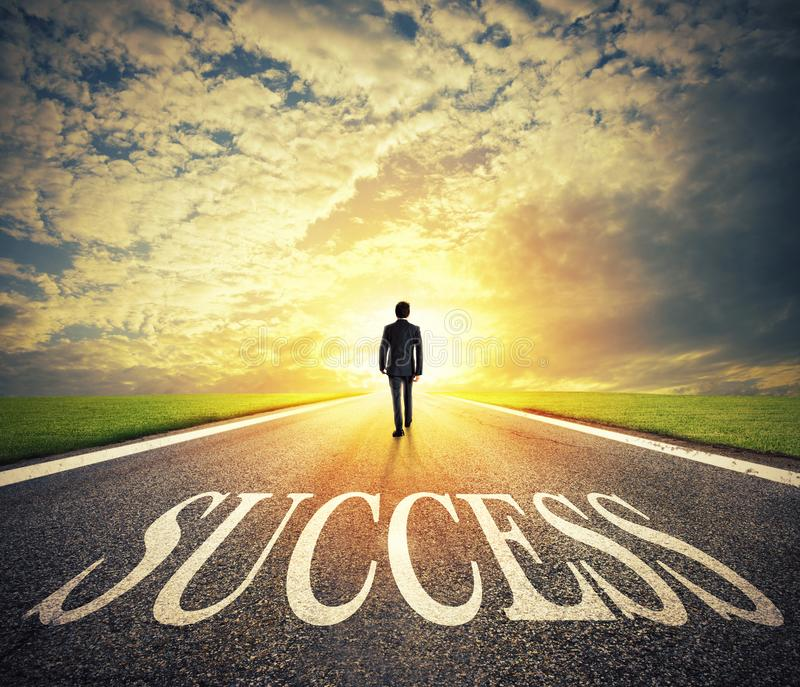 Man walks on a success way. Concept of successful businessman and company startup royalty free stock photography