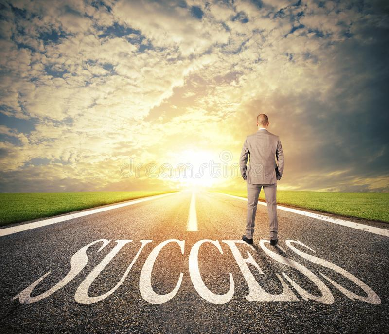 Man walks on a success way. Concept of successful businessman and company startup royalty free stock photo