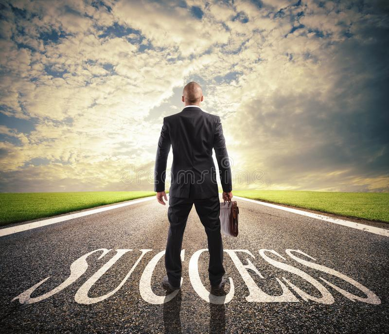 Man walks on a success way. Concept of successful businessman and company startup stock photos
