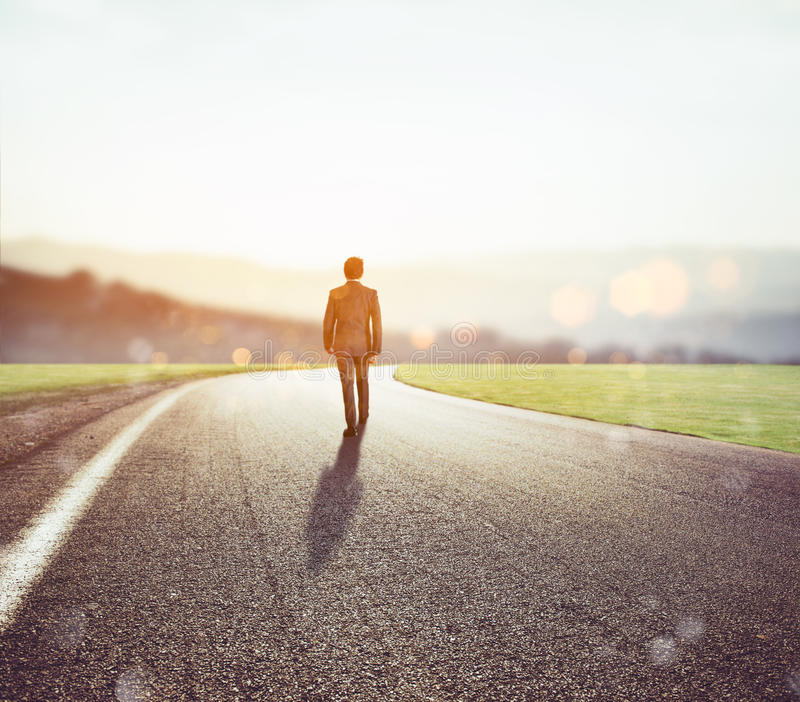 Man walks on an unknown road for a new adventure stock photography