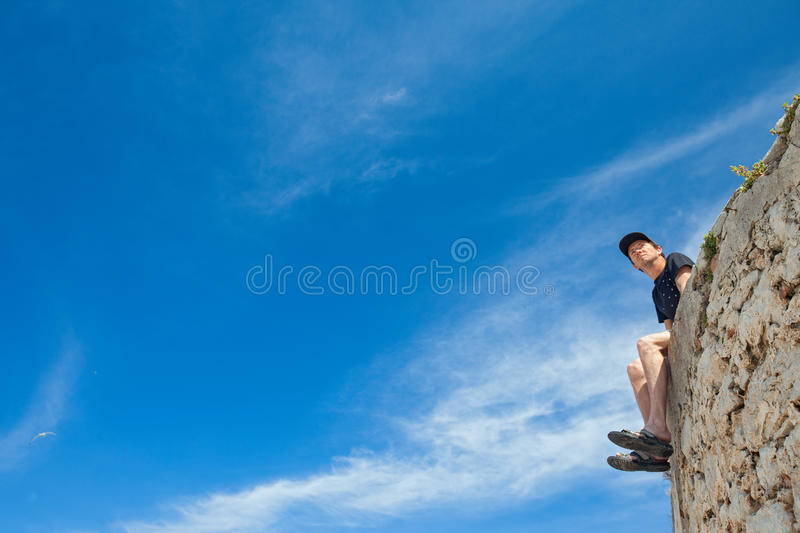 Man on wall stock images