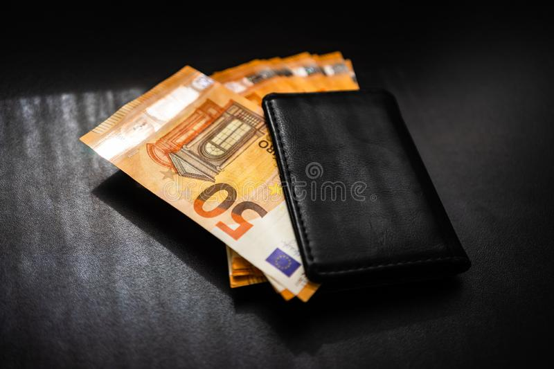 Man wallet with money on the table, wallet with EURO.  royalty free stock photo