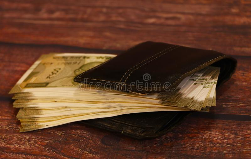 Man wallet with money on the table, wallet with Indian currency. Business, businessman. stock image