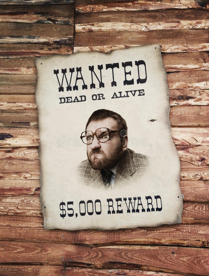Man on the wanted list royalty free stock photography
