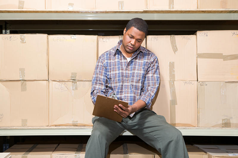 Man in warehouse stock image