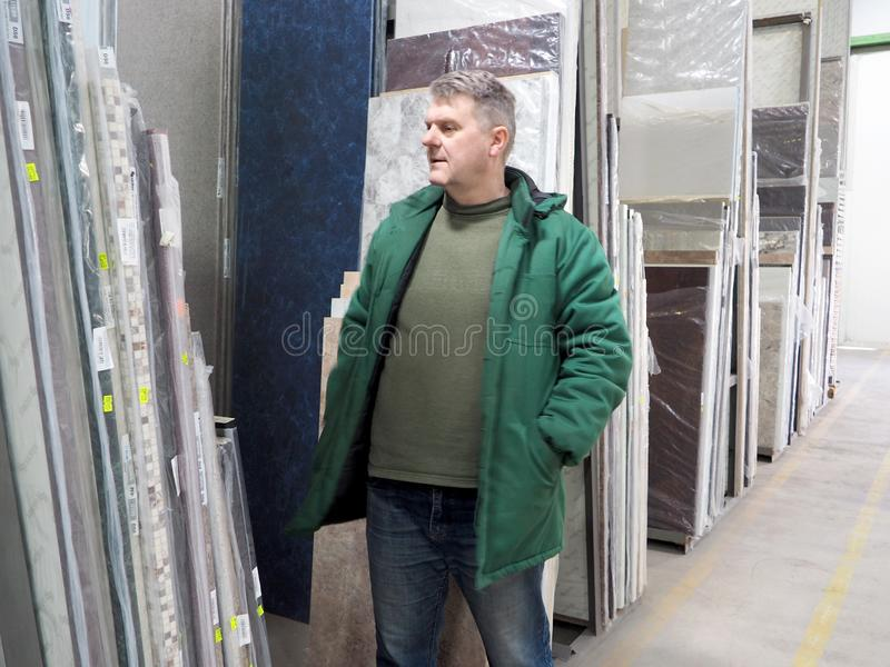 Man in a building materials warehouse royalty free stock photography