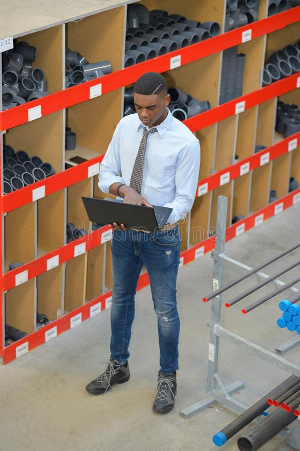 Man warehouse worker with tablet royalty free stock images