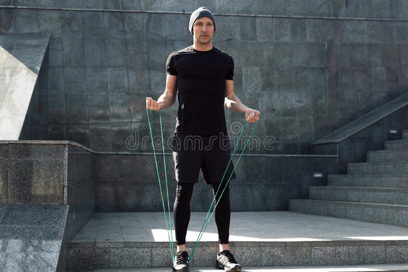 Man warming up with jumping rope stock photo