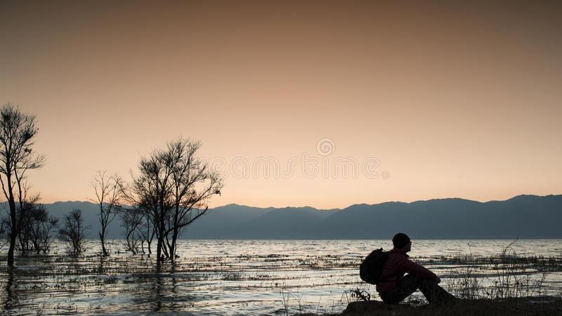 Man was sitting by the erhai lake royalty free stock photo