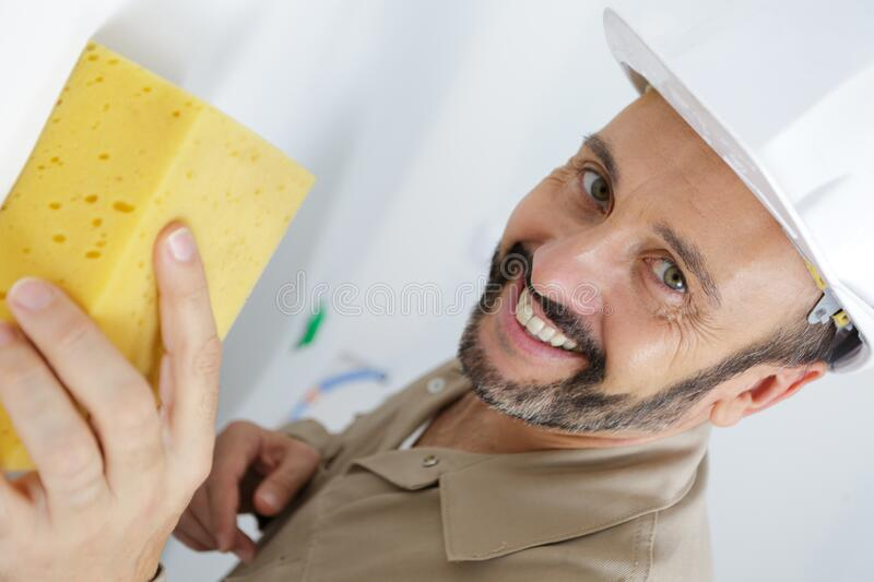 Man washes wall royalty free stock images