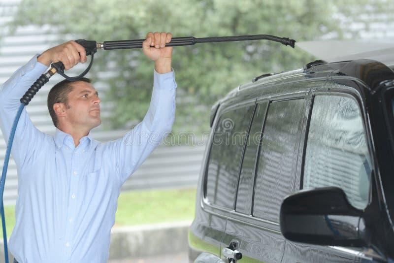 Man washing car at carwash stock images
