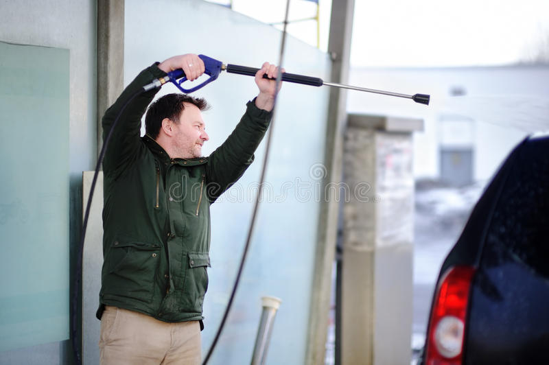 Man washing a car on a carwash stock photography