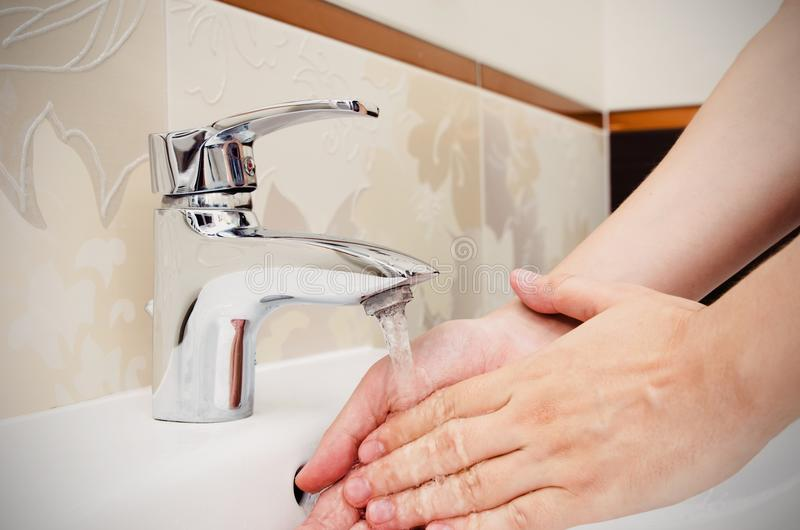 Man washing hands in bathroom. Utilities water bill cost rise wash hand composition stock photos