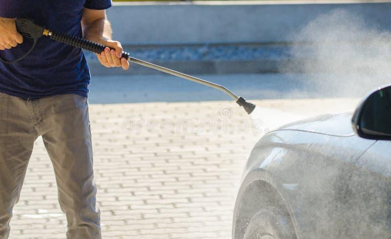 Man washing his car at a carwash stock photo