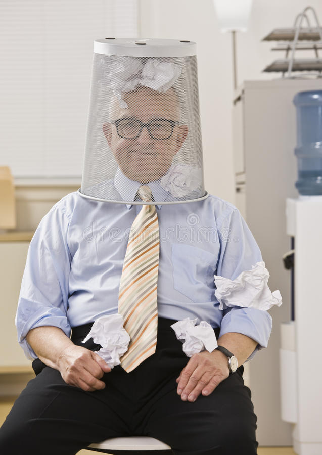 Download Man With Wastebasket On Head Stock Image - Image of trash, indoors: 10012103