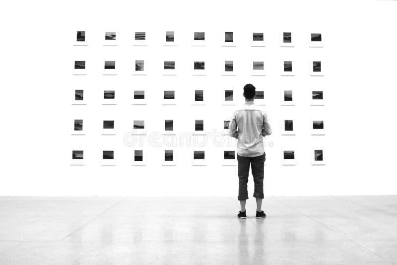 Man watching art stock images