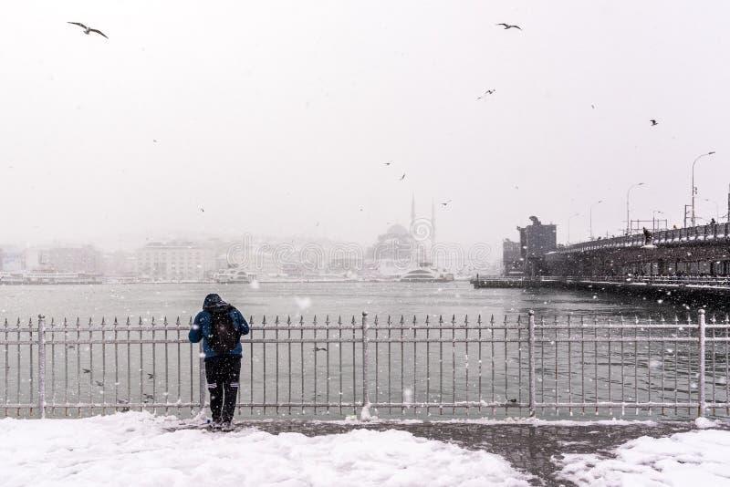 Man watching bosphorus on the heaviest snowfall. Unidentified man watching bosphorus on the heaviest snowfall in Istanbul,Turkey stock photos