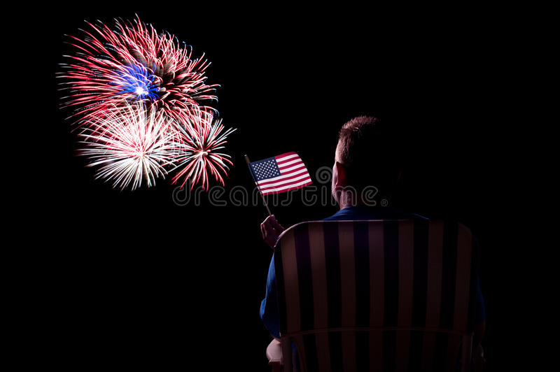 Man watching fireworks stock photos