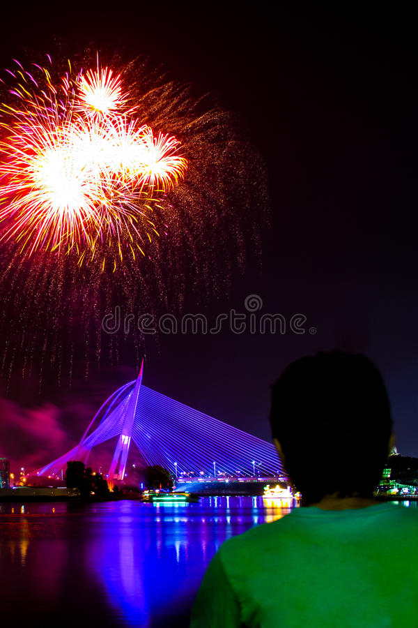 A man watching fireworks display royalty free stock photography