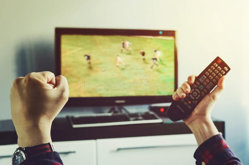 Man watching football match on television at home. royalty free stock images
