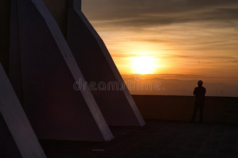 Man watching an incredible sunrise, panoramic view of the city of San andres Cholula Puebla royalty free stock photo