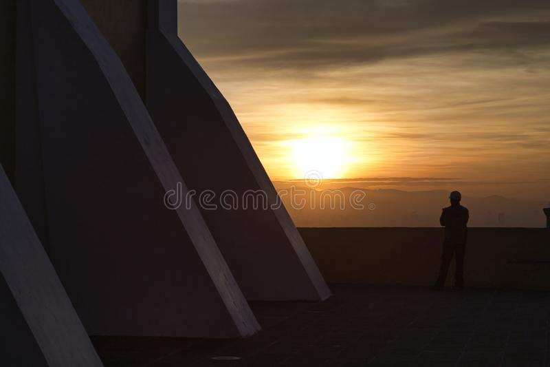 Man watching an incredible sunrise, panoramic view of the city of San andres Cholula Puebla royalty free stock photography