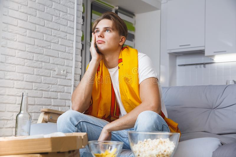Man watching sport on tv at home alone boring game royalty free stock images