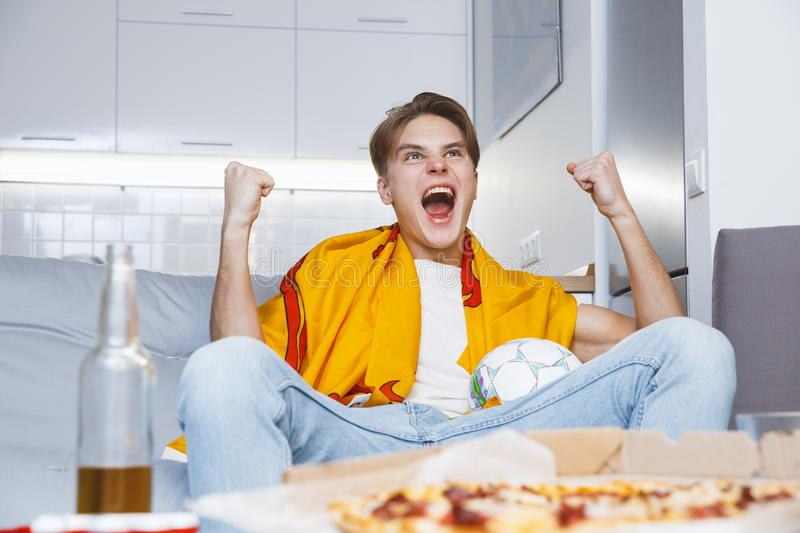 Man watching sport on tv at home alone win bottom view stock photo
